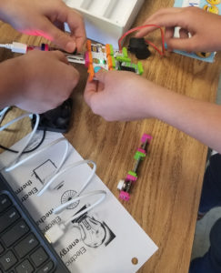 Hands working together with littleBits.