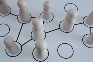 Game pieces on a game board. Image by Gerd Altmann from Pixabay