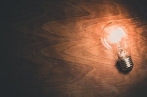 A light bulb on wooden floor. Image by Free-Photos from Pixabay